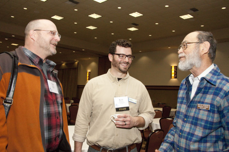 Attendees at the Wetland Science Conference enjoying each other's company.