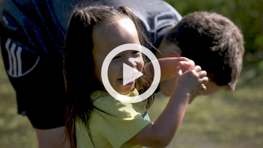Video thumbnail of a smiling child in a wetland.