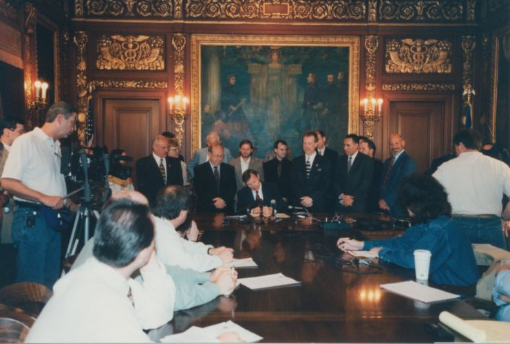Charlie Luthin, WWA's first Executive Director, joins legislators for signing the 2001 isolated wetlands bill into law.