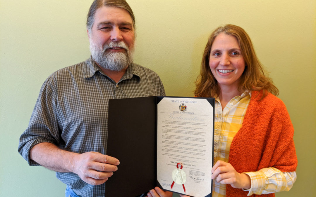WWA's Tracy Hames and Jennifer Western Hauser hold the official proclamation.